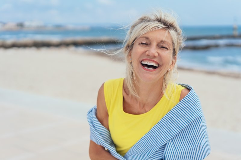Woman on a beach during summer smiling
